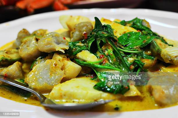 Stir fried fish ball in green curry sauce with bas