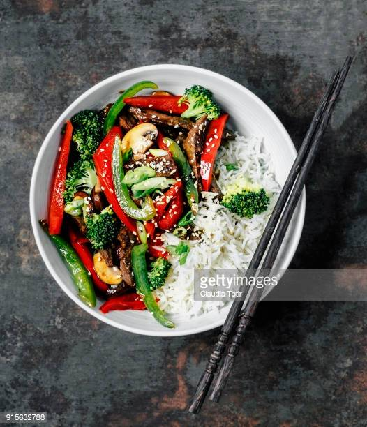 stir-fried beef with vegetables and rice - stir fried stock pictures, royalty-free photos & images