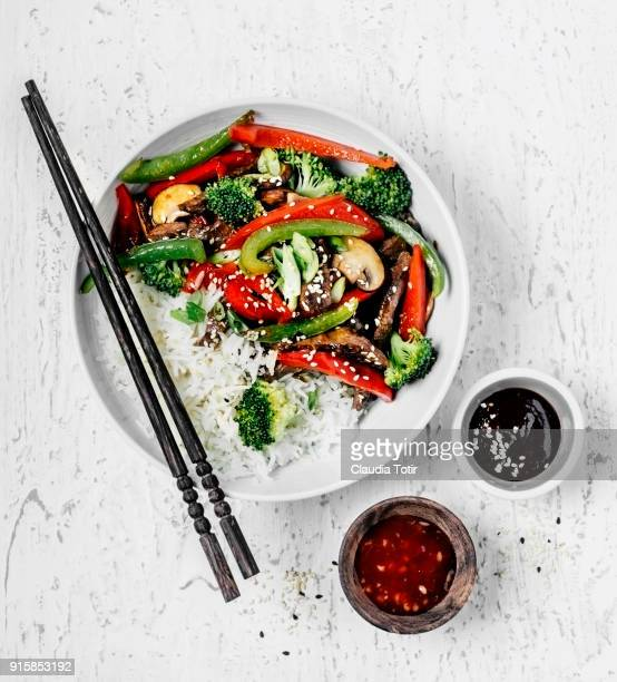 stir-fried beef with vegetables and rice - asian food stock pictures, royalty-free photos & images