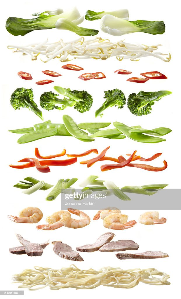Stirfry ingredients separated into layers : Stock Photo