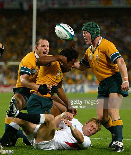 Stirling Mortlock Lote Tuqiri and Elton Flatley of Australia celebrate the opening try of the Rugby World Cup Final match between Australia and...