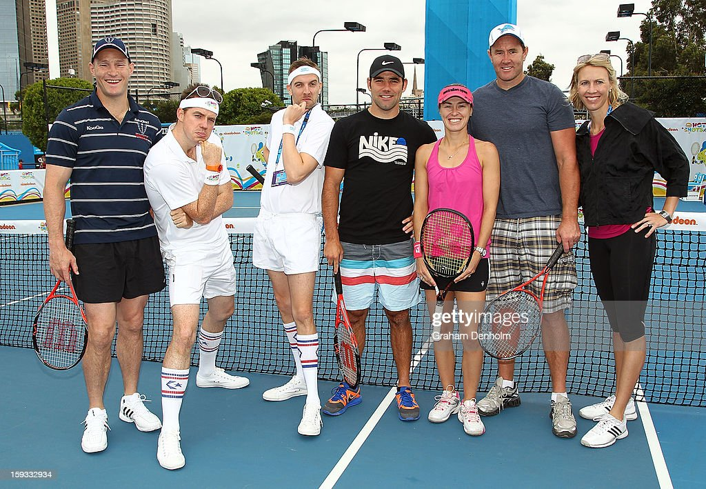 Stirling Mortlock, Nickelodeon hosts, Cameron Smith, Martina Hingis, Ben Graham and Alicia Molik pose prior to the Celebrity Slam match as part of Kids Tennis Day ahead of the 2013 Australian Open at Melbourne Park on January 12, 2013 in Melbourne, Australia.