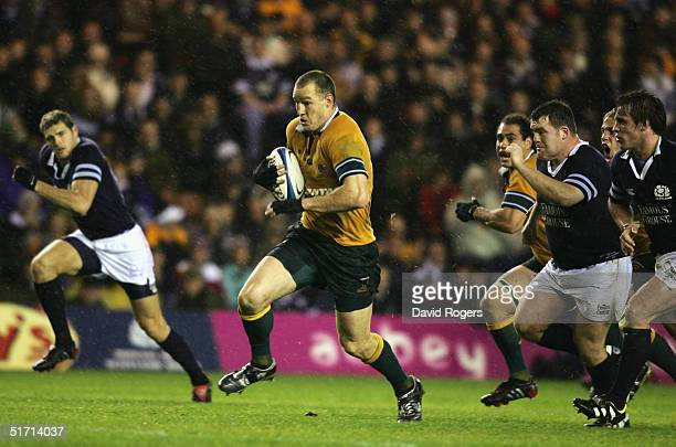 Stirling Mortlock of Australia splits the Scottish defence during the Rugby Union International match between Scotland and Australia at Murrayfield...