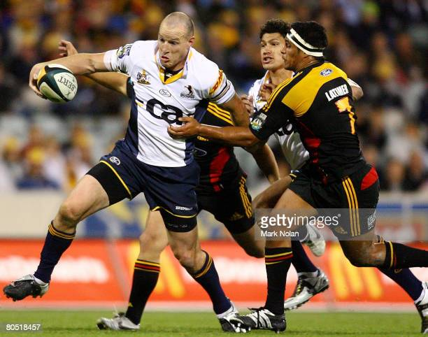 Stirling Mortlock of the Brumbies makes a line break during the round eight Super 14 match between the Brumbies and the Chiefs at Canberra Stadium on...