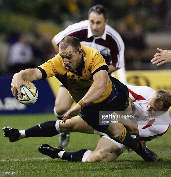 Stirling Mortlock of the Wallabies lunges for a try during the Second Cook Cup match between the Australian Wallabies and England at the Telstra Dome...