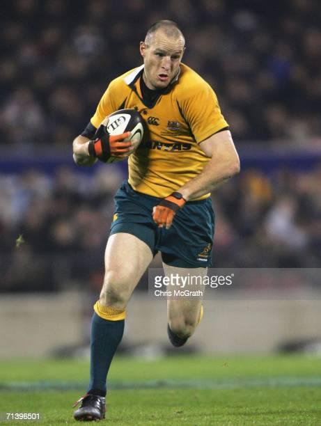 Stirling Mortlock of the Wallabies makes a break during the Tri Nations series Bledisloe Cup match between the New Zealand All Blacks and the...