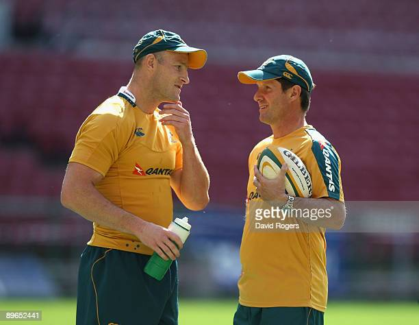 Stirling Mortlock talks to head coach Robbie Deans during the Wallabies captain's run at Newlands Stadium on August 7 2009 in Cape Town South Africa