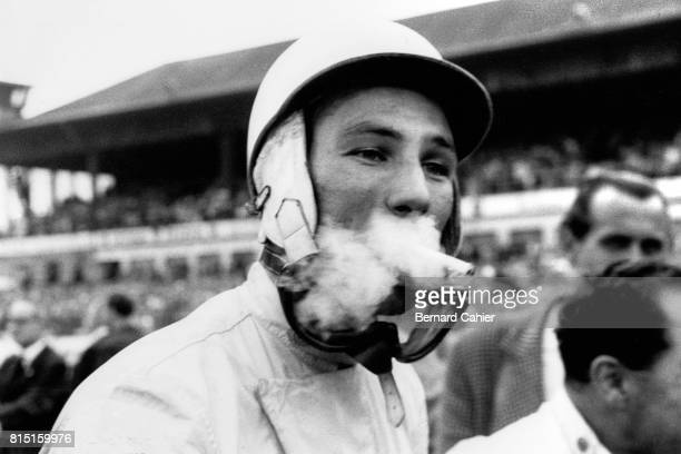 Stirling Moss 1000 Km of Nurburgring Nurburgring Germany June 7 1959 Stirling Moss smoking a cigarette in a cloud of smoke