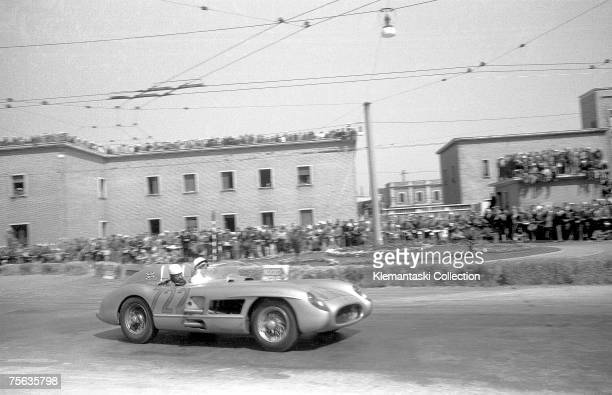 Stirling Moss and Denis Jenkinson passing through the town of Ancona on the Adriatic coast in their Mercedes Benz during the Mille Miglia which they...