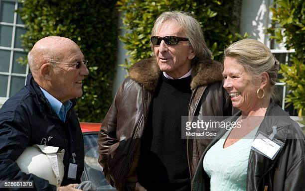 Stirling Moss and his wife Susie with Derek Bell