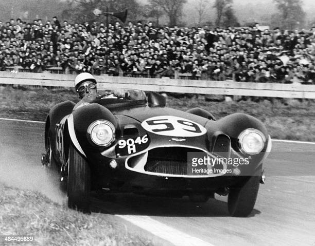 Stirling Moss diving an Aston Martin DB3S Goodwood West Sussex 1956 Moss won this race the Goodwood Easter race one of many racing successes achieved...