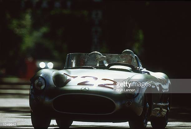 Stirling Moss drives the 1955 MercedesBenz 300 SLR at the Goodwood Festival of Speed June 14 2002 at Goodwood House Near Arundel England