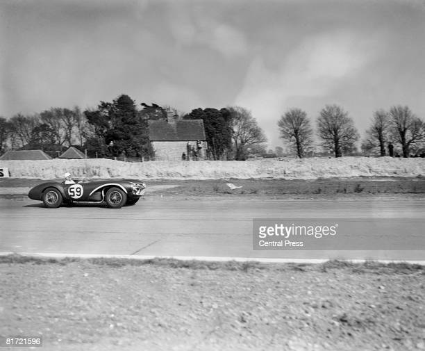 Stirling Moss driving an Aston Martin at Goodwood April 1956