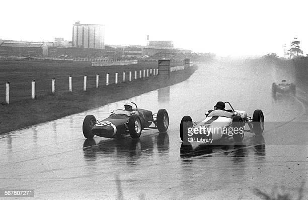 Stirling Moss in a Walker Lotus 1821 passing Ian Burgess in Camoradi Lotus 18 with special nose British Grand Prix Aintree England 15 July 1961