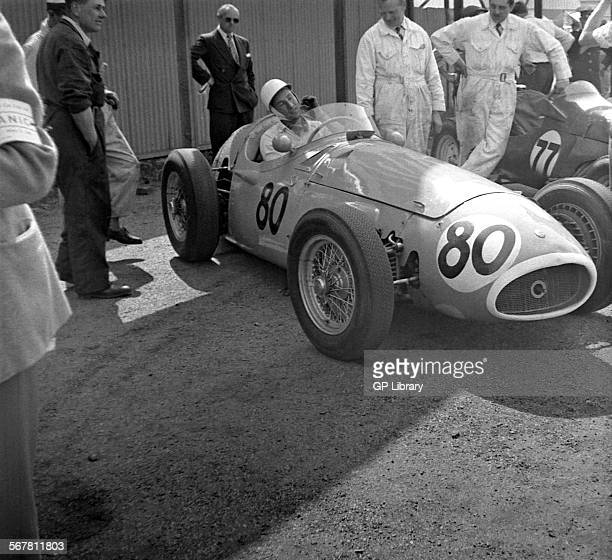 Stirling Moss in his Maserati 250F