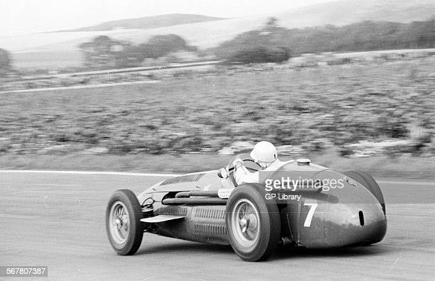 Stirling Moss in his Maserati 250F racing at Goodwood England 7 June 1954