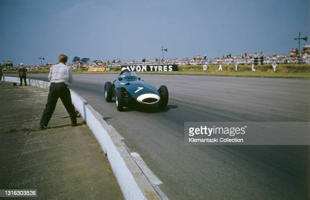 Stirling Moss in his Vanwall was always an inviting target for race photographers, British Grand Prix, Silverstone.