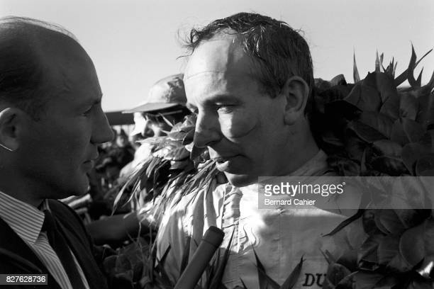 Stirling Moss Johhn Surtees Grand Prix of Mexico Autodromo Hermanos Rodriguez 25 October 1964 Stirling Moss interviewing John Surtees after he...
