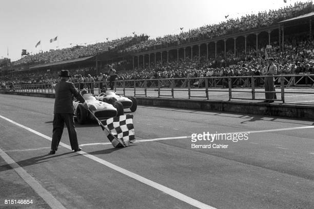 Stirling Moss Juan Manuel Fangio Grand Prix of Great Britain Aintree England July 16 1955 Stirling Moss wins the British Grand Prix ahead of Fangio