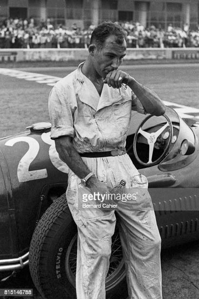 Stirling Moss Maserati 250F Grand Prix of Italy Monza Italy September 5 1954 Stirling Moss drinking a Coke given to him by Bernard Cahier after...