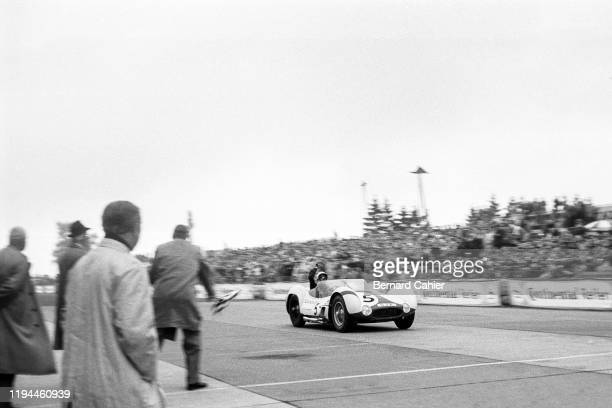 Stirling Moss, Maserati Tipo 61, Nürburgring 1000 Kilometres, Nurburgring Nordschleife, 22 May 1960. Stirling Moss takes the checkered flag and...