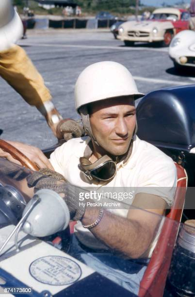 Stirling Moss of England sits in his Aston Martin DBR2 as he waits for the start of the 4th Annual International Bahamas Speed Weeks Nassau Trophy...