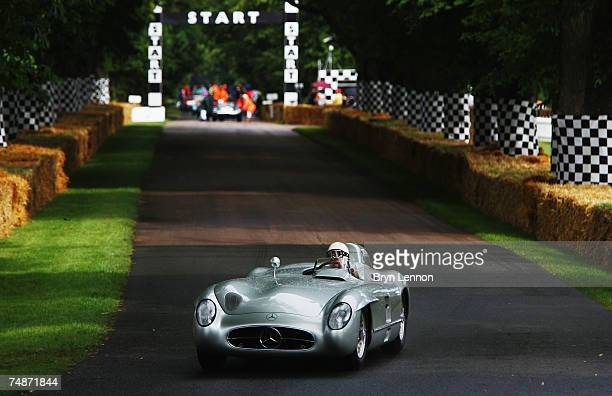 Stirling Moss of Great Britain drives up the hill in a MercedesBenz 300SLR at the Goodwood Festival of Speed on June 23 2007 in Chichester England