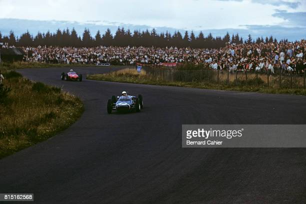 Stirling Moss, Phil Hill, Lotus-Climax 18, Ferrari 156, Grand Prix of Germany, Nurburgring, Germany, August 6, 1961.