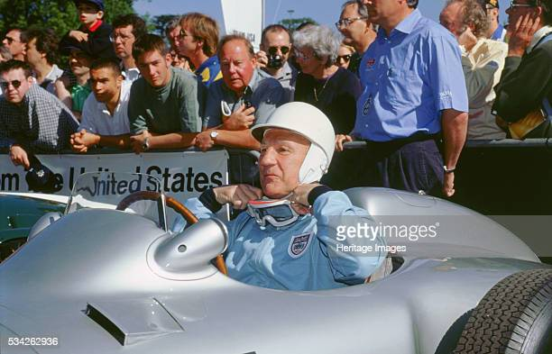 Stirling Moss readies himself in the paddock at Goodwood festival of speed West Sussex 2000