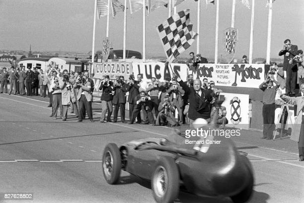 Stirling Moss, Vanwall VW 5, Grand Prix of Great Britain, Aintree, 20 July 1957. Checkered flag and historic first victory of a British car in a...