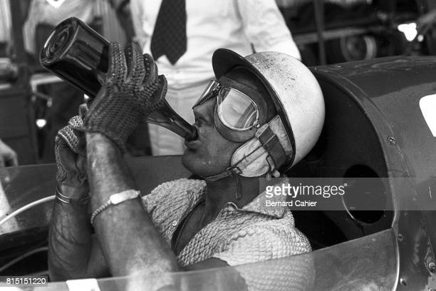 Stirling Moss Vanwall VW 5 Pescara Grand Prix Pescara Italy August 18 1957 Stirling Moss drinking water during a pit stop