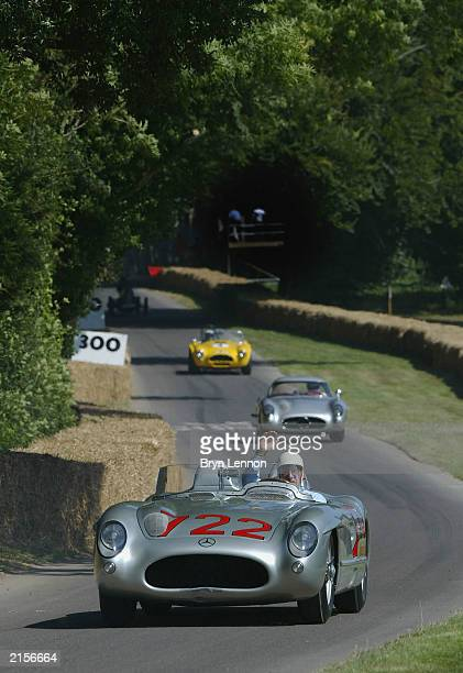 Stirling Moss waves to the crowd after during the Goodwood Festival of Speed at Goodwood House on July 13 2003 in Chichester England