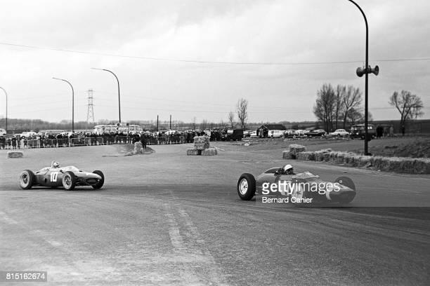 Stirling Moss Willy Mairesse LotusClimax 18/21 Ferrari 156 Grand Prix of Brussels at Heysel Park Brussels Belgium April 1 1962