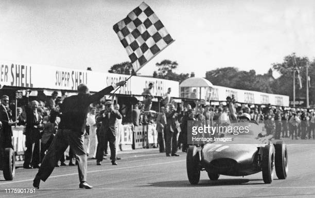 Stirling Moss winning 1957 British Grand Prix at Aintree in the Vanwall