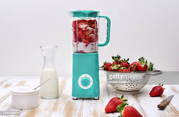 stirred strawberry - strawberry milkshake and nobody stock pictures, royalty-free photos & images