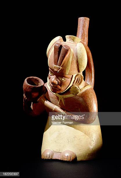 Stirrup spouted Mochica portrait jar depicting a noble pouring out water or chicha beer probably as a libation associated with fertility rituals...