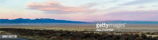 xxxl stitched panorama. the sunrise in nevada, the lincoln highway 6 / 93 near be tonopah and ely usa - alex potemkin or krakozawr stock pictures, royalty-free photos & images