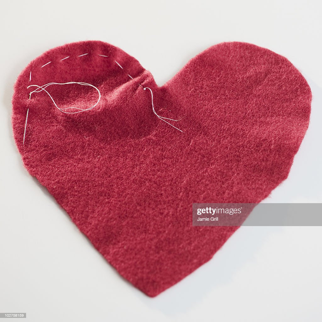 Stitched red heart : Stock Photo