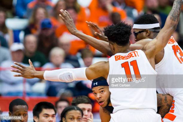 J Stith of the Old Dominion Monarchs is trapped in the corner by Oshae Brissett and Paschal Chukwu of the Syracuse Orange during the second half at...