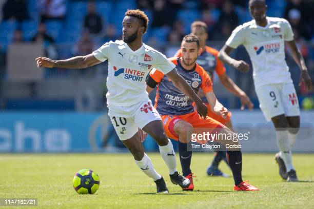 Stiven Mendoza of Amiens defended by Ellyes Skhiri of Montpellier during the Montpellier Vs SC Amiens French Ligue 1 regular season match at Stade de...