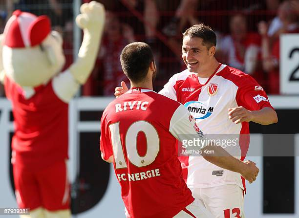 Stiven Rivic of Cottbus jubilates with team mate Ervin Skela after scoring the second goal during the Bundesliga match between FC Energie Cottbus and...