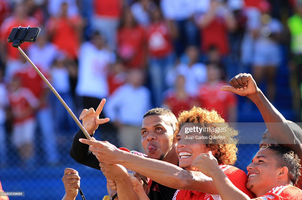 Stiven Tapiero of America de Cali celebrates celebrates taking a selfie after scoring the second goal of his team during a match between America de Cali and Bogota FC as part of 17th round of Torneo Aguila 2015 at 12 de Octubre Stadium on July 12, 2015 in Tulua, Colombia.