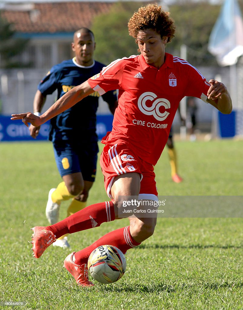Stiven Tapiero of America de Cali plays the ball during a match between America de Cali and Bogota FC as part of 17th round of Torneo Aguila 2015 at 12 de Octubre Stadium on July 12, 2015 in Tulua, Colombia.