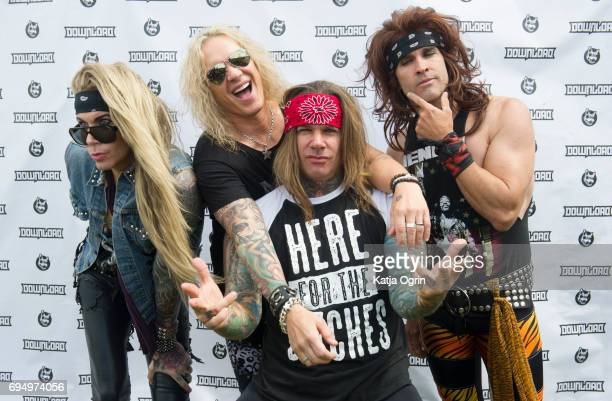 Stix Zadina Michael Starr Satchel and Lexxi Foxx of Steel Panther posing backstage on Day 3 of Download Festival at Donington Park on June 11 2017 in...