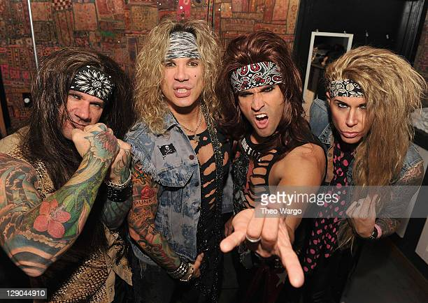 Stix Zadinia, Michael Starr, Satchel and Lexxi Foxxx of Steel Panther backstage at Gramercy Theatre on October 11, 2011 in New York City.