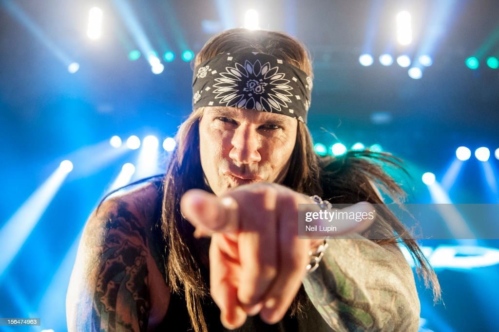 Stix Zadinia of Steel Panther performs on stage at Hammersmith Apollo on November 15, 2012 in London, United Kingdom.