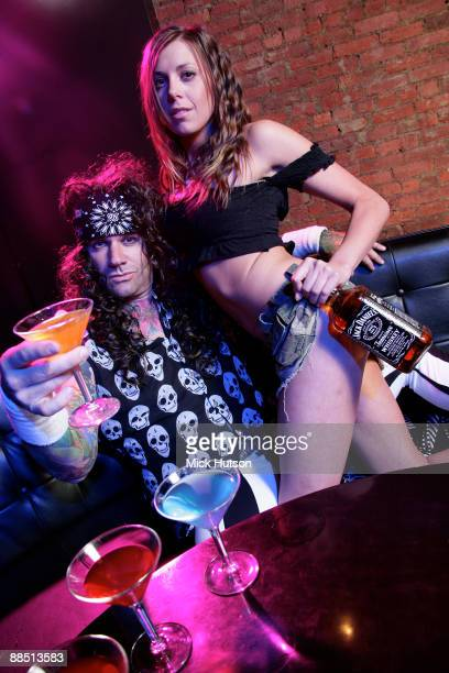Stix Zadinia of Steel Panther poses with model cocktails and bottle of Jack Daniel's at the Canal Room on April 1st 2009 in New York
