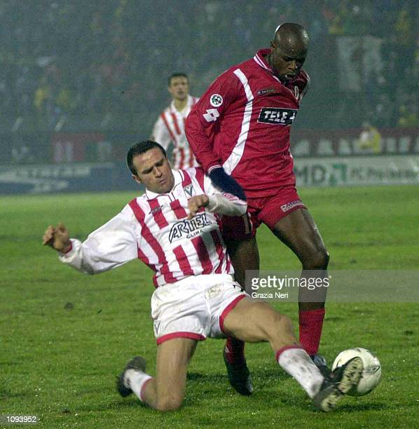 Stjepan Tomas of Vicenza and Philemon Masinga of Bari in action during a SERIE A 13th Round League match between Vicenza and Bari played at the Romeo...