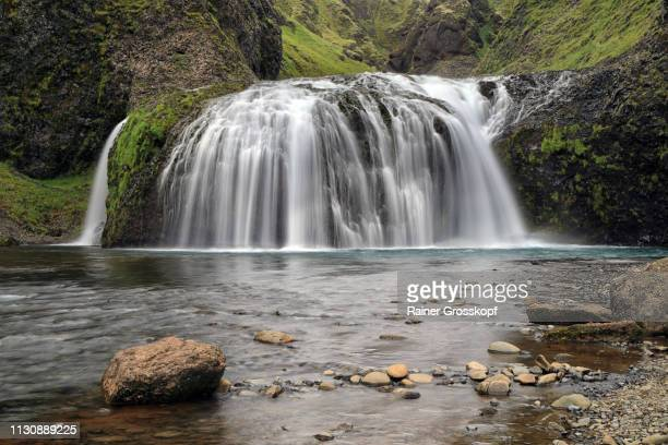 stjornafoss waterfall in south iceland - rainer grosskopf fotografías e imágenes de stock