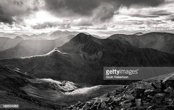 Stob Ban stands 3277 feet tall in the Mamores mountain range Glen Nevis Scotland with the sprawling mountains of Glencoe in the background. Taken in...